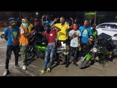Portmore ENDS bikers pose for a shot after completing their rounds on a no-movement day two weeks ago.