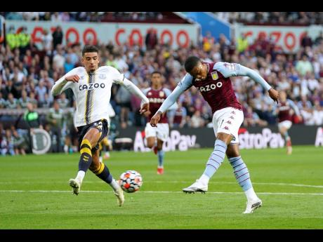 Aston Villa's Leon Bailey (right) scores during the English Premier League match between Aston Villa and Everton at Villa Park, Birmingham, England, yesterday. Villa won 3-0.