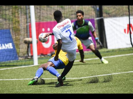 Mount Pleasant's Devonte Campbell (foreground) scores against Harbour View's goalkeeper Tafari Chambers, while under pressure from Lovel Palmer during a Jamaica Premier League first leg quarter-final match at the UWI-JFF-Captain Horace Burrell Centre