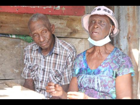 Leopold Hamilton and his wife, Ena, of Nine Turn, Clarendon, lament the state of affairs in their community.