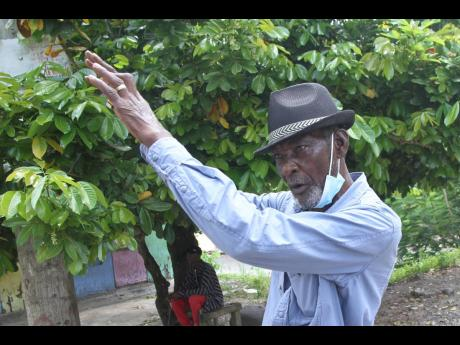 """Keith Benjamin says that should you become ill in the night, """"dawg nyam yu supper!"""" because the few public passenger vehicles that ply the routes in Brandon Hill, Clarendon, don't operate at night because of the bad road condition."""