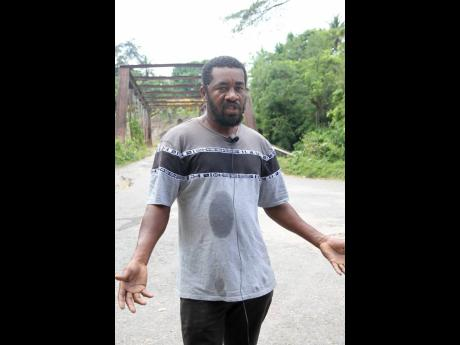 Lennox Smith, a farmer from Brandon Hill, Clarendon, says residents are tired of the promises over the years and are now hoping for road repairs.