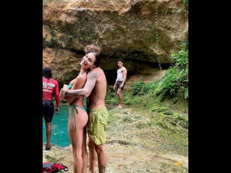 Recording artiste Justin Bieber embraces wife Hailey at Blue Hole in Ocho Rios. It was one of a number of images Hailey shared in a recent Instagram post.