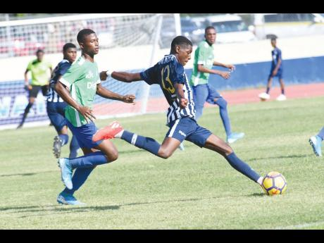 Jamaica College's Tajay Grant (right) winds up a shot while being tracked by Vauxhall High School's Jahmaree Rowe during an ISSA/Digicel Manning Cup match at Ashenheim Stadium in St Andrew on Friday, September 13, 2019.