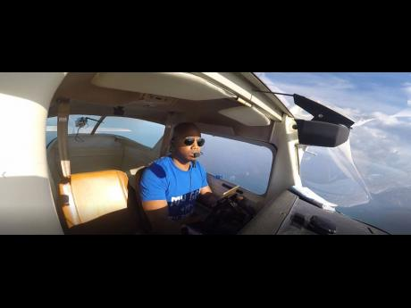 Accountable Manager of the Aeronautical School of the West Indies (ASWI), Gari Tomlinson, on one of his solo flights.  Tomlinson turned his love for flying into a business opportunity by partnering with Christopher Gooding to start ASWI.