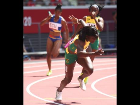 Jamaica's Remona Burchell passes the baton to teammate Shericka Jackson (front) during the semi-final round of the Women's 4x100m Relay event at the Olympic Games in Tokyo, Japan on Thursday, August 5. Jamaica Athletics Administrative Association Presi