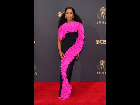 'Gunpowder Milkshake' actress Angela Bassett brought vibrant, hot pink ruffles, to the red carpet in a statement-making dress by  Jamaican-Canadian design duo, Greta Constantine.