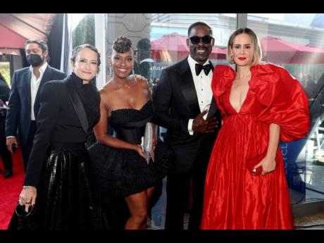 From second left: Ryan Michelle Bathe, Sterling K. Brown, and Sarah Paulson, right, arrive at the Emmy Awards.