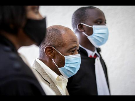 Paul Rusesabagina (centre), whose story inspired the film 'Hotel Rwanda' for saving people from genocide, appears at the Kicukiro Primary Court in the capital Kigali, Rwanda. A court in Rwanda said yesterday that Rusesabagina is guilty of terror-relate