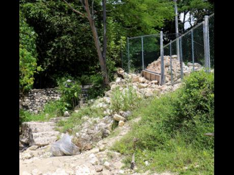The newly erected chain-link fence restricting access to the Urban Development Corporation (UDC)-managed Bluefields Beach via the Bluefields Bay Villas property. The villa operators and the UDC are urging the public to access the beach through its formal e