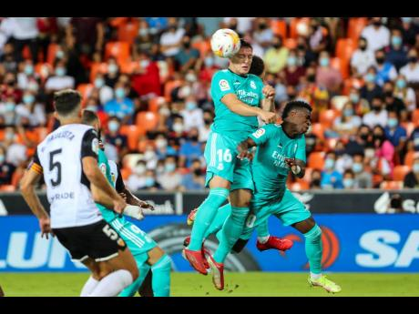 Real Madrid's Luka Jovic (centre) gets a head to the ball during a Spanish LaLiga match against Valencia at the Mestalla Stadium in Valencia, Spain on Sunday.
