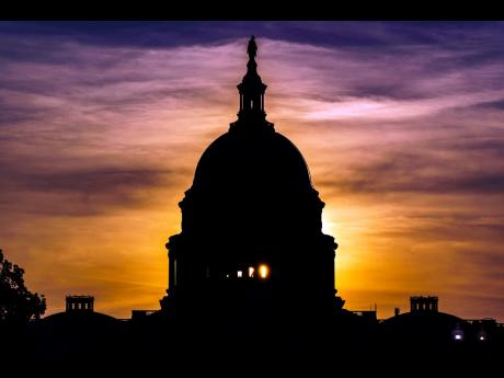 The sun rises behind the Capitol in Washington, Wednesday, Sept 15, 2021.