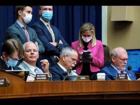 """US House Energy and Commerce members, seated from left, Representatives Brett Guthrie, David McKinley and Morgan Griffith., listen during votes on amendments during work on the """"Build Back Better"""" package, cornerstone of US President Joe Biden's dome"""