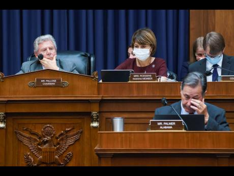 """House Energy and Commerce Chairman Frank Pallone, D-N.J., left, with Rep Cathy McMorris Rodgers, R-Wash., the ranking member, work on the """"Build Back Better"""" package, a cornerstone of President Joe Biden's domestic agenda, at the Capitol in Washingto"""