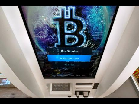 The Bitcoin logo appears on the display screen of a cryptocurrency ATM.