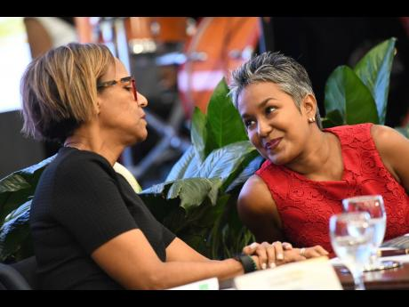 Marla Dukharan, right, in conversation with Therese Turner-Jones, general manager, Country Department Caribbean Group of the IDB.