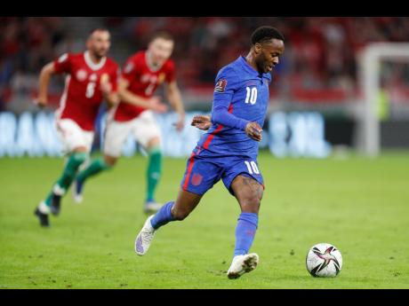 England's Raheem Sterling runs with the ball during the World Cup 2022 Group I qualifying match against Hungary at the Ferenc Puskas Stadium in Budapest, Hungary, on Thursday, September 2.
