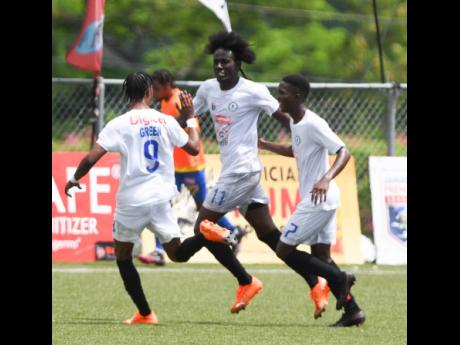 Mount Pleasant's Kesslon Hall (centre) celebrates with teammates Devonte Campbell (right) and Daniel Green during a Jamaica Premier League first leg quarter-final match against Harbour View at the UWI-JFF-Captain Horace Burrell Centre of Excellence on Sa