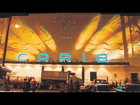 After a devastating fire in 1996, the Carib reopened in 1997 as the new and technology-driven Carib 5 – five cinemas in one. The edifice is seen here bathed in lights as part of the grand celebrations.