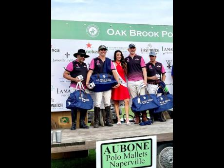 From left: Charles Chambers, chief executive officer of West Indies Petroleum and Jamaican team member; Jamaican Pro Jason Wates; Miss Oak Brook Polo Julie Bouchard; Jamaican Pro Freddie Farquharson, teammate Santi Torres.