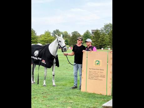The Best Playing Pony Award recipient, Santi Torres (right), poses proudly with the winning horse, Galactica, and its owner.