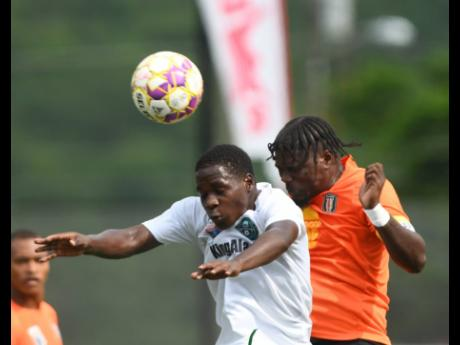Vere United's Tyrece Harrison (left) comes under pressure from Tivoli's Barrington Pryce during their Jamaica Premier League first leg quarter-final match at the UWI-JFF-Captain Horace Burrell Centre of Excellence on Saturday, September 18, 2021. The m