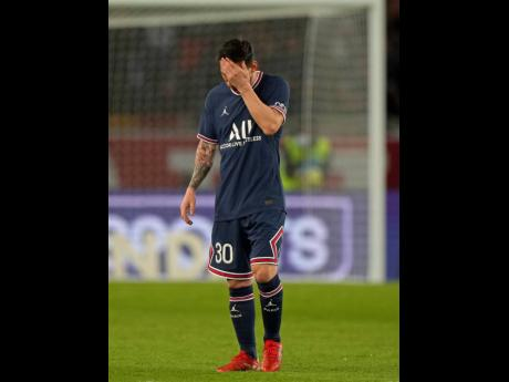 LEFT: PSG's Lionel Messi reacts after Lyon's Lucas Paqueta scored the opening goal during the French League One soccer match between Paris Saint-Germain and Lyon at the Parc des Princes in Paris on Sunday.