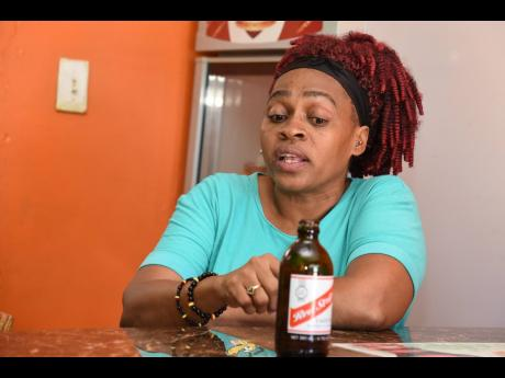 Odette Clarke, operator of K's Chill Spot in Port Henderson Plaza, says Red Stripe's 'full-for-empties' policy has deeply affected her business.