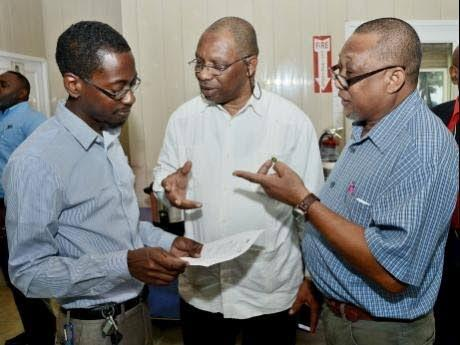 From left: Dr Orville Grey talks shop with Jeffrey Spooner, former head of the Meteorological Service, and Clifford Mahlung, one of Jamaica's seasoned climate negotiators, at a consultation session in 2015.