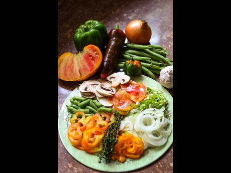 Chopped seasonings and vegetables create a colourful palette.