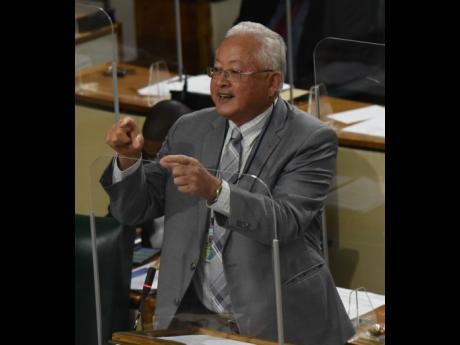 Delroy Chuck, minister of justice, addresses Parliament on Tuesday.