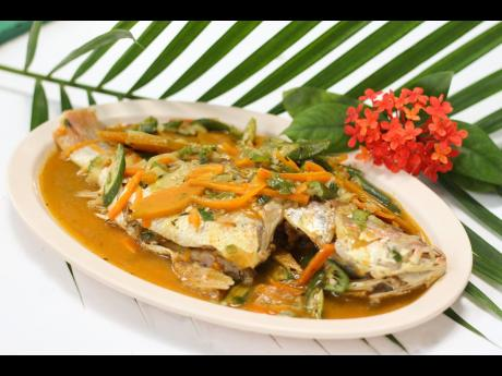 There's nothing more mouth-watering than Chef Damion Sewell's juicy steamed snapper topped with pumpkin, carrots and okra.