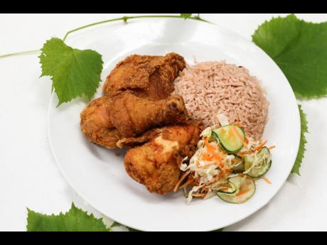 Fried chicken served with rice and peas could almost be Jamaica's national dish. From lunchtime until dinner hours, every day of the week, Our Place always has this Jamaican staple on the menu.