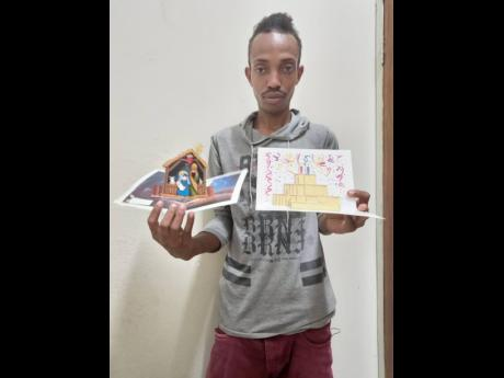 Self-taught software developer and graphic artist Dareego Gordon displays some of his pop-up cards. He is seeking help to establish a business to be able to find a suitable home and sustain himself.