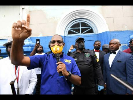 Organiser Joseph Patterson, head of the United Independent Congress, addresses protesters during yesterday's march, moments before he was arrested and charged.