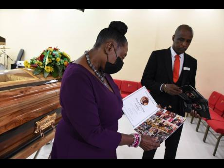 Peter Perry (right), chief executive officer of Perry's Funeral Home and Olivia 'Babsy' Grange, Minister of Culture, Gender, Entertainment and Sport, at the viewing for late musical icon Lee 'Scratch' Perry held at the Spanish Town, St Catherine funeral ho