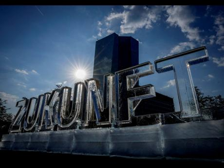 AP Letters of melting ice reading 'Zukunft' or 'Future' was set up by Greenpeace activists in front of the European Central Bank in Frankfurt, Germany, on Thursday, September 9.