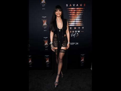 Musician and entrepreneur  Rihanna showed out on the black carpet in thigh highs, jewels and lace, kick-starting the preview of her new collection which will no doubt feature more lace, more thigh highs, cat suits and crotchless pieces.