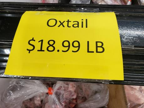 A sign in a Caribbean store on Main Street in East Orange, New Jersey, advertising oxtail for US$18.99 (more than J$2,800 per pound).