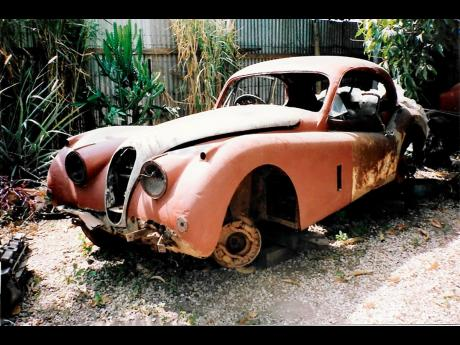 The banged-up Jaguar XK 140 seen here in Jamaica in 1988. It was restored in the United Kingdom in 2006.