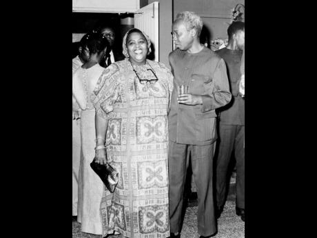 The Honourable Louise Bennett-Coverley, OJ, conversing with President Julius K. Nyerere of Tanzania at the Little Theatre where a performance by the National Dance Theatre Company was staged in his honour.