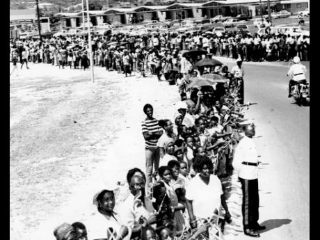 A section of the large crowd which lined the Harbour View roundabout  on September 14 to greet President Julius K. Nyerere on his arrival in Jamaica for the start of a four-day official visit.