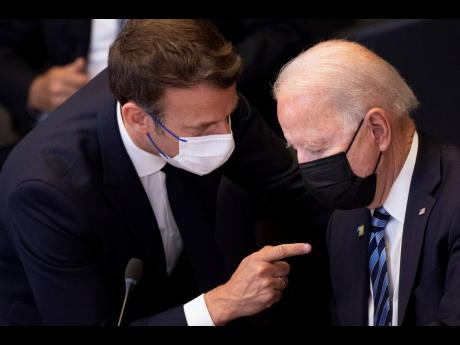 AP In this June 14 file photo, US President Joe Biden, right, speaks with French President Emmanuel Macron during a plenary session at a NATO summit at NATO headquarters in Brussels.