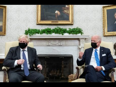 AP US President Joe Biden, right, speaks during a meeting with British Prime Minister Boris Johnson in the Oval Office of the White House on Tuesday, September 21, in Washington DC.