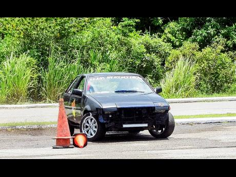 Matthew McKenzie cuts it really close to the cone at a past dexterity event.