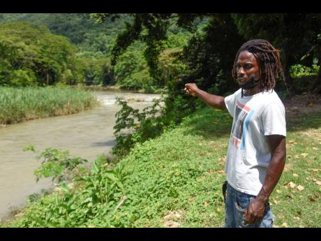 Fisherman Daniel Gayle lamenting the impact the contamination of the Rio Cobre in St Catherine was having on the livelihoods of residents of Kent Village.