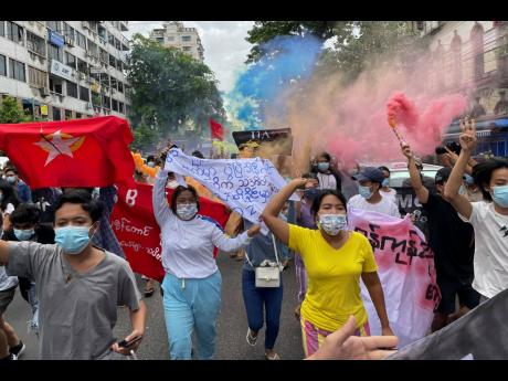 In this July 7 file photo, students protest against the February military takeover by the State Administration Council as they march at Kyauktada township in Yangon, Myanmar.