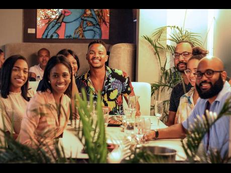 This happy group were out to celebrate their friends' birthdays, but were interested to know more about the new menu. From left: Birthday girl Shari-Anne Watson, Jahdielle Owens, Asia Drummond, Christoper Boxe, birthday boy Russell Meghoo, Jessica Thomps