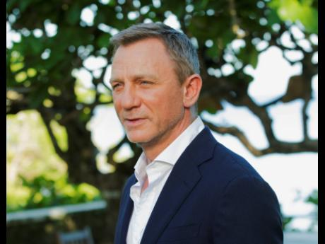 """Daniel Craig during the photo call of the latest installment of the James Bond film franchise, currently known as """"Bond 25,"""" in Oracabessa, Jamaica."""