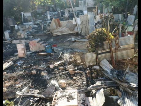 The scorched wreckage of three houses that were destroyed by arsonists at Gordon Crescent in Granville, St James, on Sunday morning.